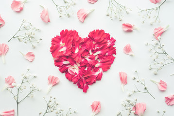 Heart shape made of flowers on white background.Flat lay. Valentines,love and wedding concept .