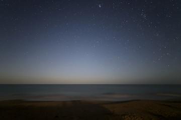 Stars on a blue sky at night on a beach