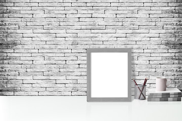 Mock up poster or photo frame and supplies on white table,hipster minimalism desk space