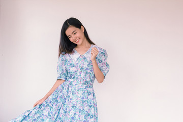 Fashion Portrait of Young cute asian woman wearing vintage blue dress