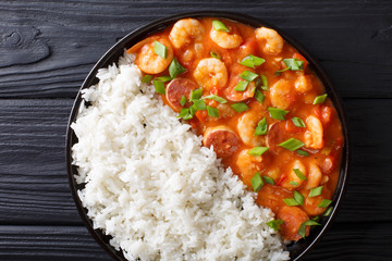 Traditional Louisiana gumbo with shrimp, sausage and rice macro on a plate. horizontal top view