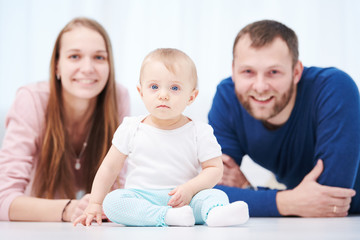 Parenting family. Mother and father playing with little newborn baby