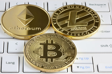 Bitcoin, Ethereum and Litecoin on the keyboard.