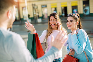 Happy friends shopping. Young friends enjoying shopping in the city.