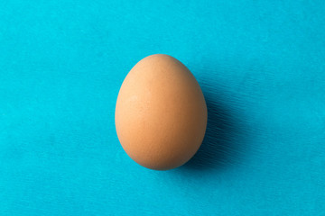 red, chicken egg on a blue background