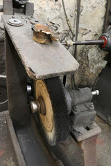 An old traditional brush at a grindery