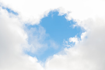 Scene bottom view of blue sky with white clouds shape half heart