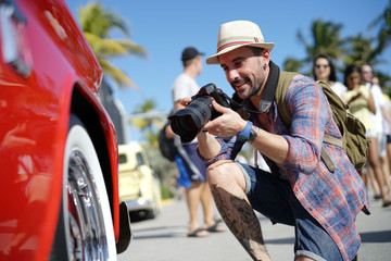 Photographer taking picture of old fashioned pick-up