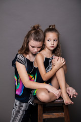 two girls posing clothes fashion