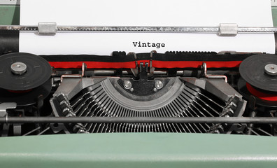 VINTAGE written with the typewriter with white page