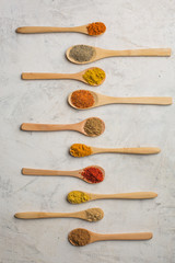 Different spices in wooden spoons