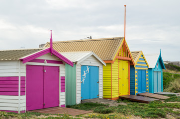 Colourful beach huts on Edithvale Beach in Melbourne.