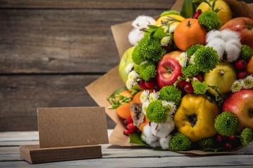 Keuken foto achterwand Keuken Original unusual edible bouquet of vegetables and fruits on wood background