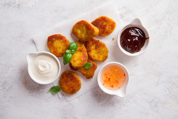 Fried crispy chicken nuggets with sauces