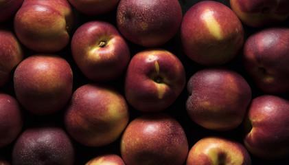 nectarine peaches on black background