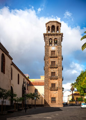 San Cristobal de La Laguna, Tenerife, Spain - December 7, 2017: View of tower of church de la Concepcion. Copy space in cloudy sky.