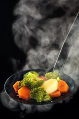 Photo sur Plexiglas Assortiment Steamed vegetables and steam.