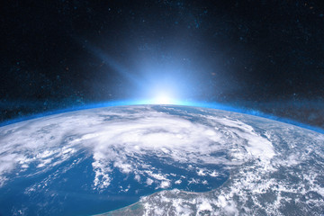 Earth in the space. Blue sunrise. Elements of this image furnished by NASA.