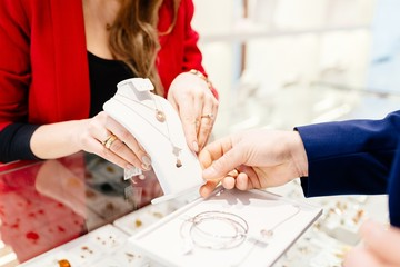 Man buying gift in jewelry store.