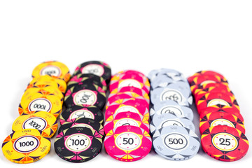 casino colorful poker chips on a white background