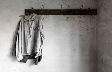 Old dirty shirts on hanger in an old garage