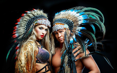 man and woman wearing Native American costumes