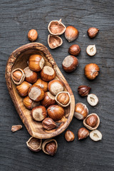 Filberts or hazelnuts in the wooden bowl on the table.