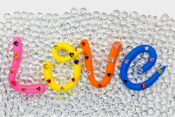 Wall Mural - the word love in colorful alphabet for valentine