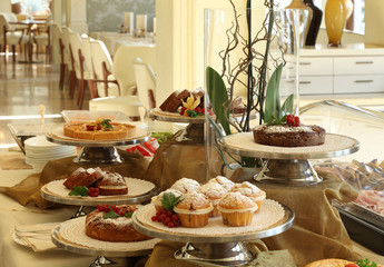 hotel breakfast with cakes and muffins