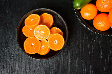 Sliced tangerine in a bowl top view