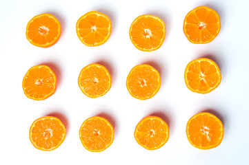 Sliced tangerine on white background flat lay