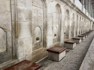 Ablution sinks in a row at mosque wall perspective view