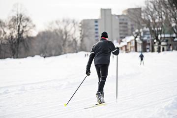 Senior man skiing on snow