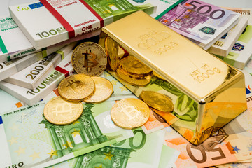 golden bitcoins with euro as a background with gold bar