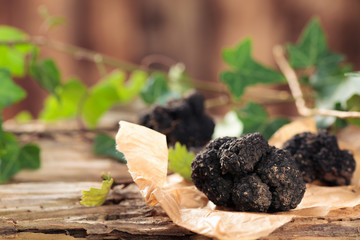 Black truffles on table.