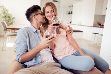 Young couple drinking wine.