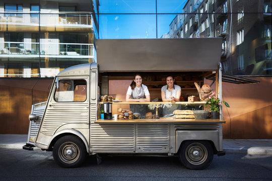 Smiling women in food truck