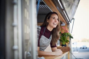 Portrait of woman in food truck