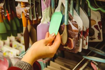 woman choose silicone kitchen spatula