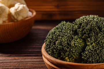 cauliflower and broccoli on a rustic background