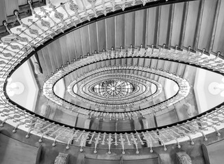 Black And White View To The Beautiful Spiral Staircase Looks Like Eyes In  Building , Spiral