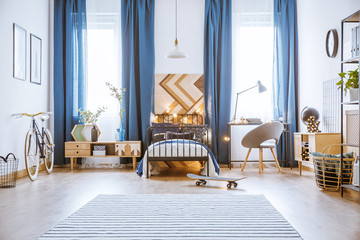 Skateboard in spacious bright bedroom