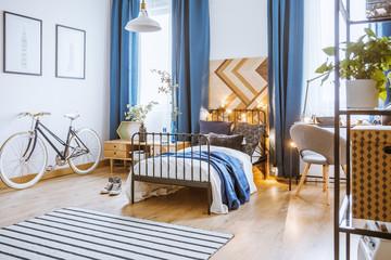 Blue drapes in cozy bedroom