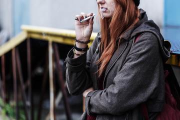 Teenager smoking cigarette