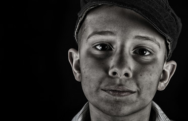 young boy on black background