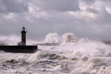 Lighthouse under heavy sea storm