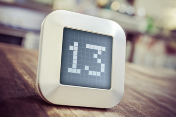 The Number 13 On A Digital Calendar, Thermostat Or Timer