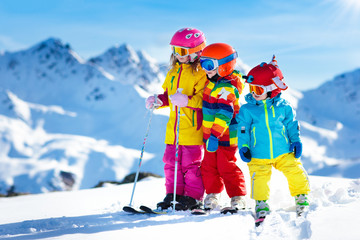 Ski and snow winter fun for kids. Children skiing.