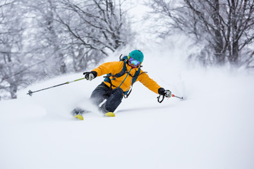 Fototapete -  A skiier is riding down the hill. Freeriding in Carpathian mountains.