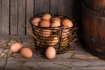 Brown Chicken Eggs on a Rustic Wooden Surface and Background
